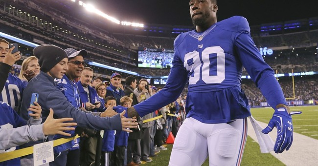 ESPN and Giants defensive end Pierre-Paul settle lawsuit