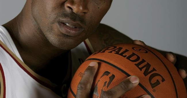 Ex-wife of Lorenzen Wright charged with murder in 2010 death