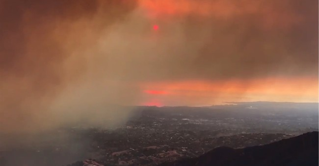 Latest: Powerful winds raise fire risk as crews battle blaze