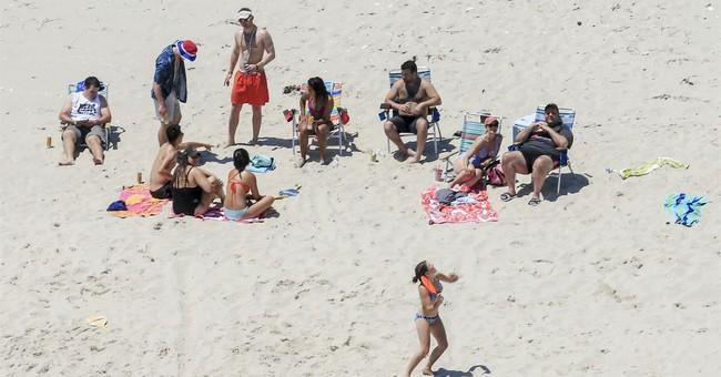Gov.-elect poses next to cutout of Chris Christie on beach