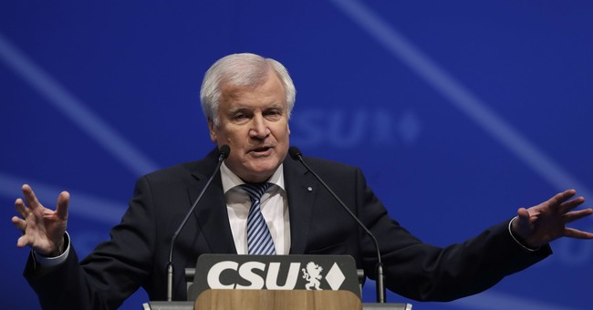 Merkel's Bavarian ally re-elects Horst Seehofer as leader