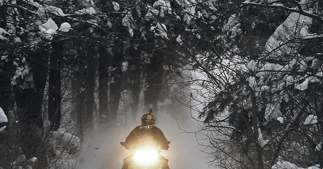 Snowmobile season off to good start in time of warming