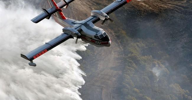 The Latest: Massive California wildfire half contained