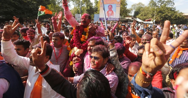 India's ruling party loses seats but still wins in Gujarat