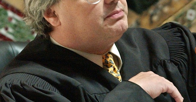 Federal judge retires as he faces accusations from women