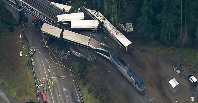 The Latest: Transit agency: Employee killed in derailment