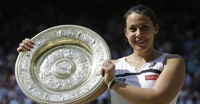 2013 Wimbledon champ Marion Bartoli says she's coming back
