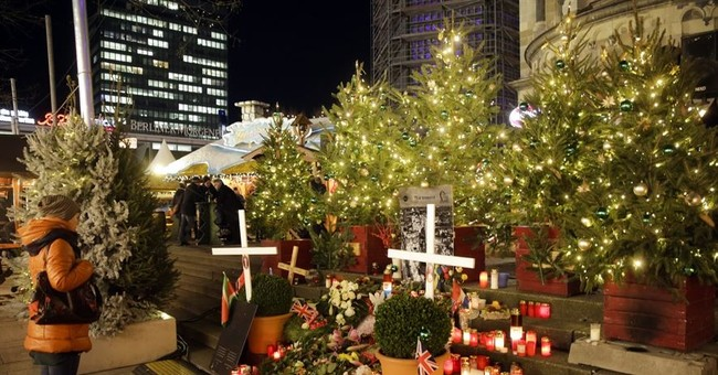 Merkel pledges to help survivors, learn from Berlin attack