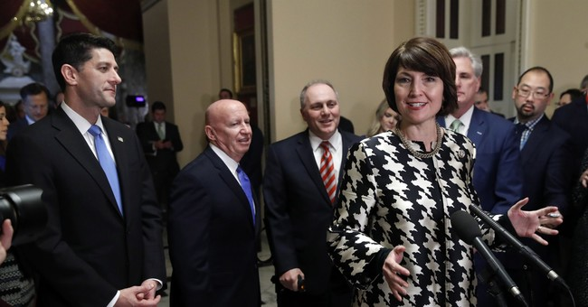 Analysis: GOP's tea party promises dashed in tax cut embrace