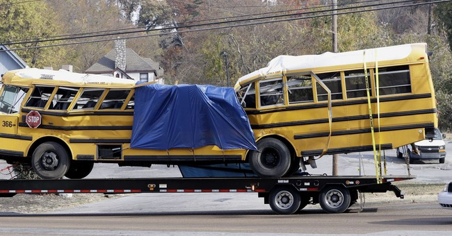 Prosecutor: Driver in deadly school bus crash was on phone