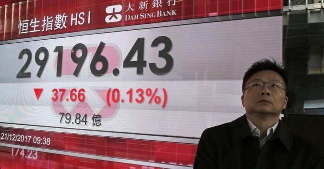 Most Asian shares lower as US tax passage fails to impress