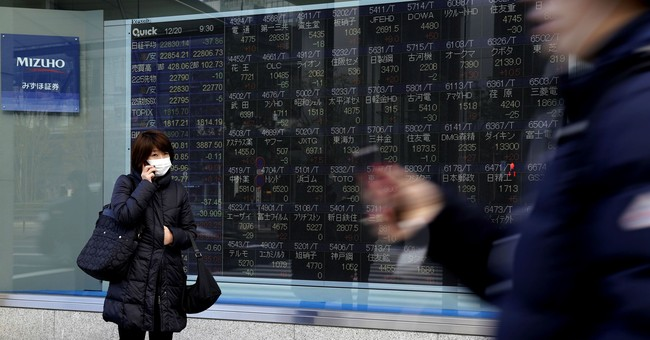 Global shares mixed in listless trading on Wall Street slip