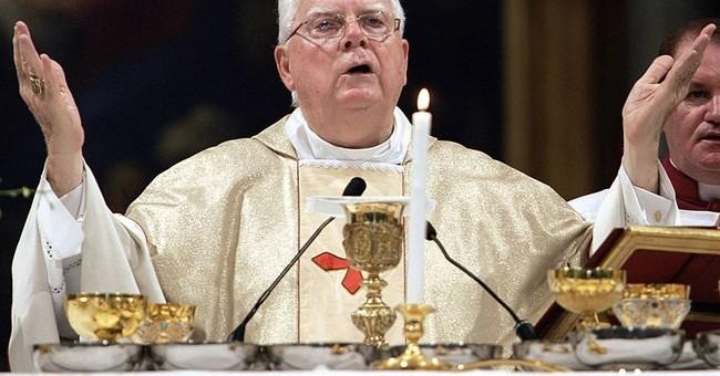 The Latest: Cardinal Law's successor dodges heaven question