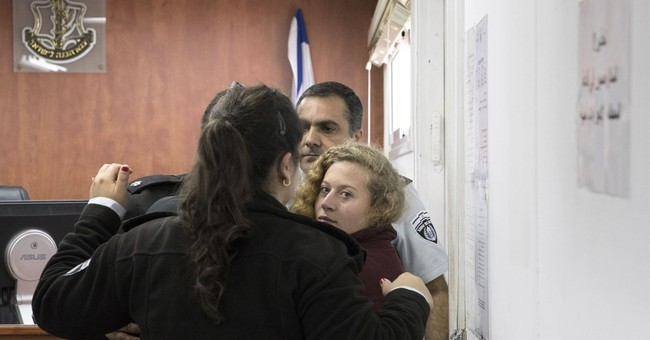 Palestinian girl praised as hero after confronting soldiers