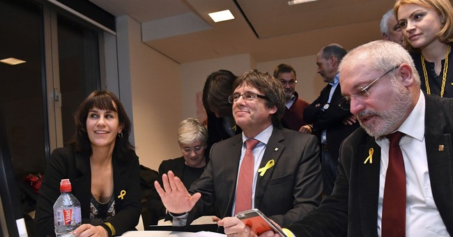 The Latest: Puigdemont: Catalan result slap in face to Rajoy