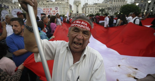 AP Explains: Why is Peru weighing president's ouster?