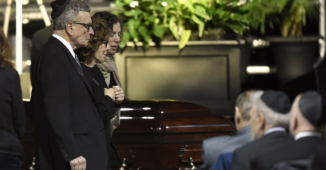 Mourners pay tribute to Toronto billionaires found dead