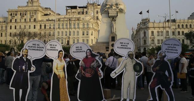 The Latest: Peru's president survives impeachment vote
