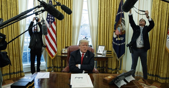 Trump signs stopgap spending bill into law to avert shutdown
