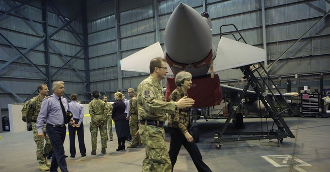 UK's May hails military personnel in Cyprus in IS fight