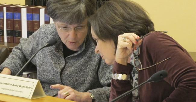 Kansas agency, firm bolster lawmaker support for prison plan