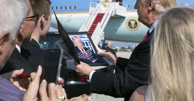 """Trump signs tax cut in """"rush job"""" Oval Office signing event"""