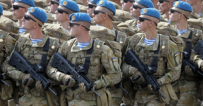 The Latest: Russia attacks US decision to arm Ukraine