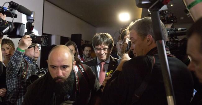 The Latest: Catalan republicans urge Spain to accept vote