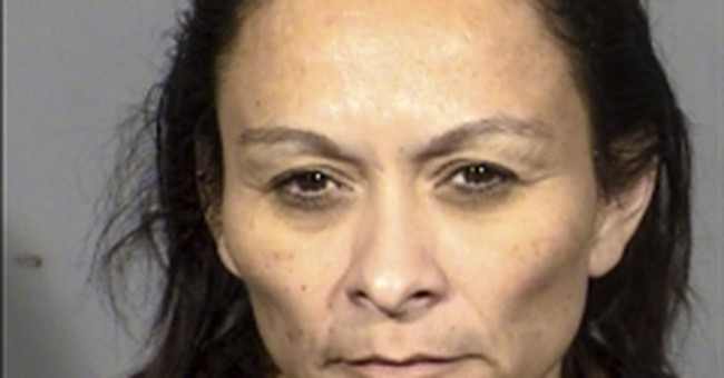 Las Vegas woman charged with gunning down 3 roommates