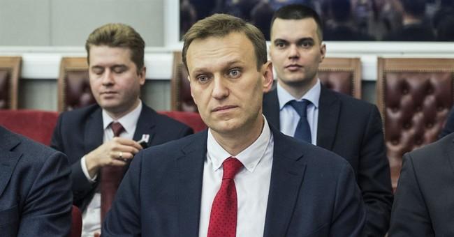 Russian officials bar Navalny from running for president