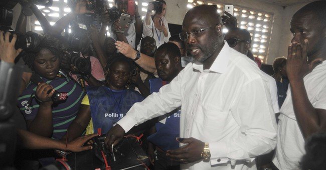 Liberia to choose between soccer star, VP in Tuesday runoff
