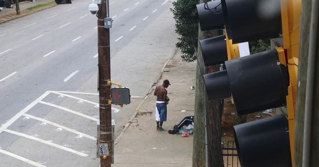 Cities, volunteers clash over feeding homeless in public