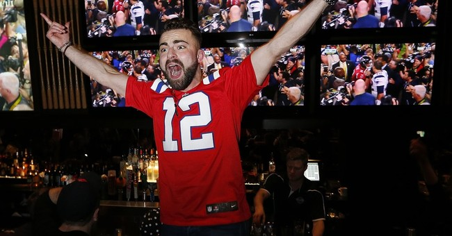 Patriots fans take to streets of Boston to celebrate victory