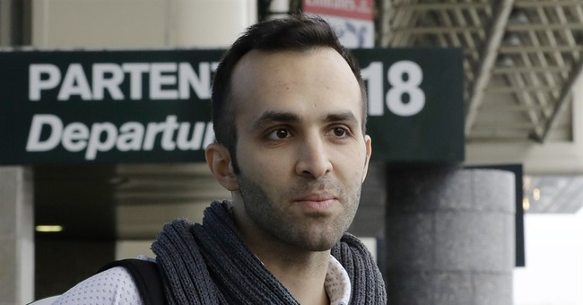 The Latest: Iranian researcher turned away, arrives at JFK