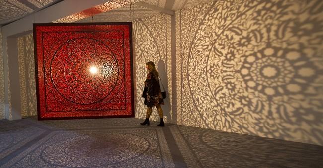Politics, migration dominate visual art fair in India