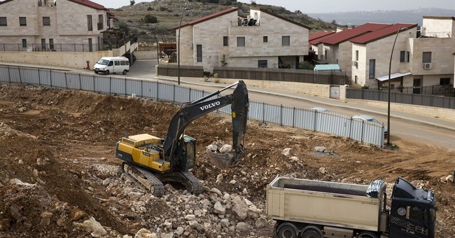 Despite White House warning, Israel pushes settlement bill