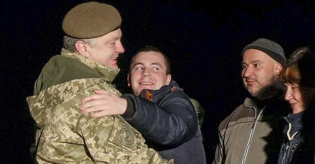Ukrainian authorities and separatist rebels swap prisoners