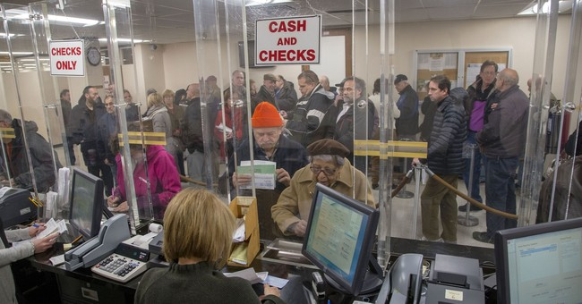 Long lines at tax offices as homeowners try to beat hike