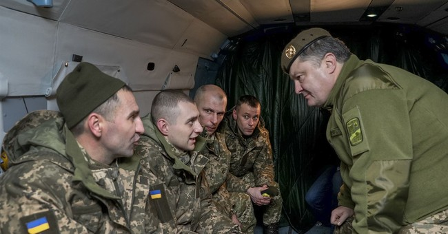 Ukrainian authorities and separatist rebels swap prisoners