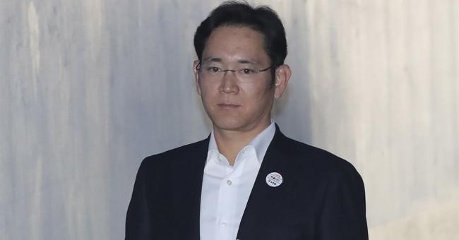 Prosecutors demand 12-year prison term for Samsung heir Lee