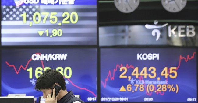 World stocks mixed as year-end nears