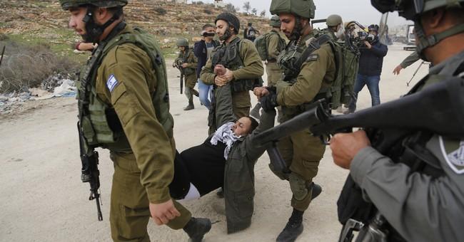 Records say paraplegic Palestinian shot during protest