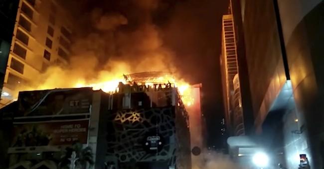 Fiery nighttime blaze kills 15 at rooftop Mumbai restaurant