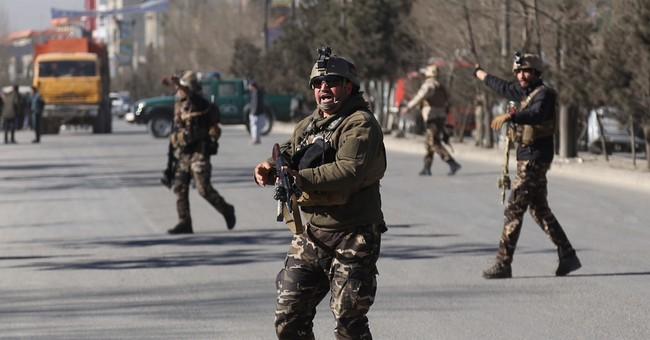 The Latest: Attack on Afghan Shiite center kills 41