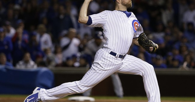 Reliever Wade Davis, Rockies agree to 3-year deal