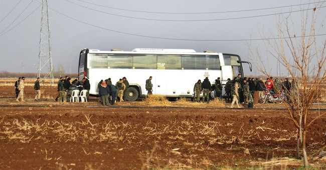 Dozens of militants evacuated from southern Syria