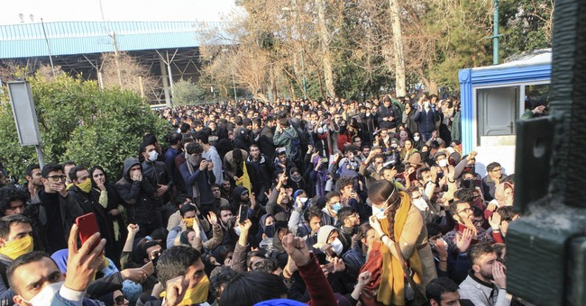 Iran protests have violent night; at least 13 dead overall