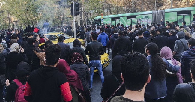 The Latest: Trump tweets new support for Iranian protesters