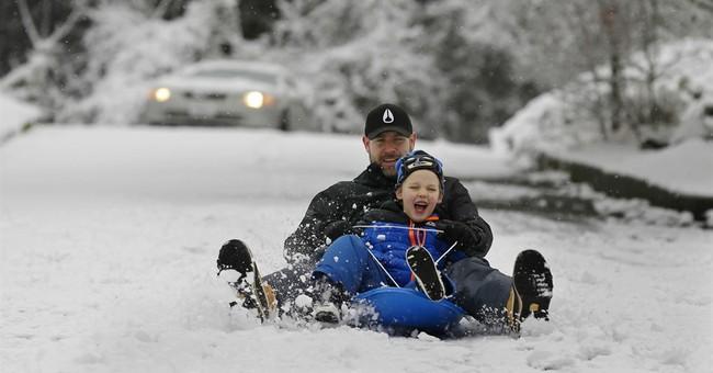 Rare snow shuts Seattle area schools, cuts power for 100,000