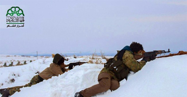 Syrian rebels and insurgents battle in split over peace push